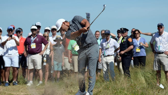 Brooks Koepka hits from the rough on the sixth hole during the final round.