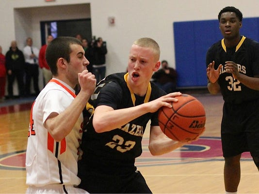 Blazes guard Tyler Constein is tightly defended by Somerset's Connor Zarefoss during Lancaster Mennonite's first round win over Somerset.  GameTimePA-Justin Bandy