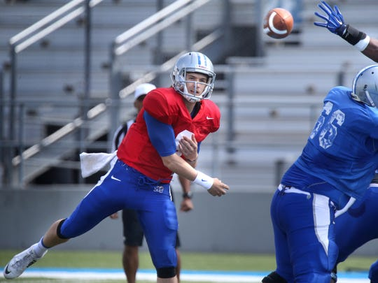 MTSU's Austin Grammer passes the ball during MTSU's first scrimmage of the season on Saturday April 4, 2015.