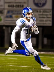 Luke Summe of Covington Catholic runs the ball against
