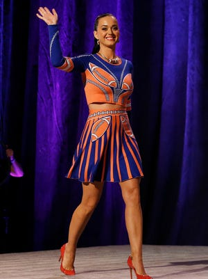 How many footballs can you count on the pop star's pre-game outfit?