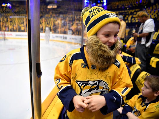 Predators John Flood, 11, of Memphis, wears a playoff beard for game 4 of the second round NHL Stanley Cup Playoffs at the Bridgestone Arena Tuesday, May 2, 2017, in Nashville, Tenn.