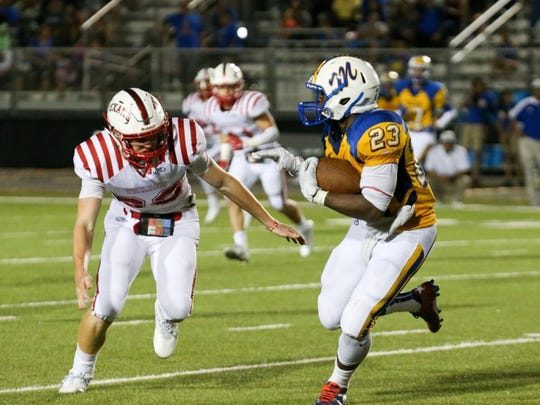 TRACY WEDDLE/SPECIAL TO THE CALLER TIMES Ray Texan Russell Sigler (24) cuts off Moody's JJ Kelley (23) on Friday, Sept. 9, 2016, at Cabaniss Multipurpose Stadium in Corpus Christi.