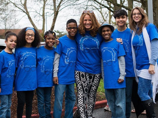 This March 20, 2016 photo shows the Hart family of Woodland, Wash., at a Bernie Sanders rally in Vancouver, Wash. Authorities in Northern California say they believe all six children from a family were in a vehicle that plunged off a coastal cliff.