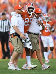 Clemson defensive back Marcus Edmond (29) is helped off the field after being injured while playing Auburn during the 1st quarter on Saturday, September 9, 2017 at Clemson's Memorial Stadium.