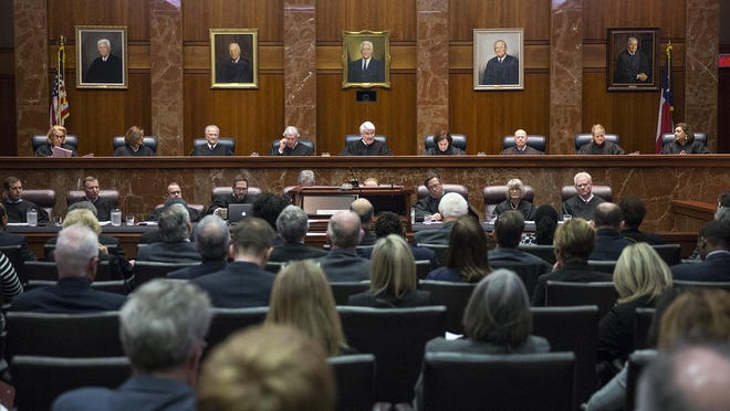 Chief Justice Nathan Hecht, center, reads an opening statement during a joint hearing between the Supreme Court of Texas and the Texas Court of Criminal Appeals in Austin in 2018. A group of Texas law schools and recent law graduates are urging the court to adjust the July bar exam in light of the pandemic.
