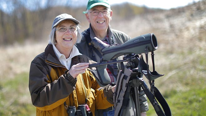 Bird watching at a distance. Christine and Steven Whitebread of the Merrymount neighborhood in Quincy out bird watching at Passanageset Park  in Broad Meadows marsh on Wednesday April 29, 2020 Greg Derr/The Patriot Ledger