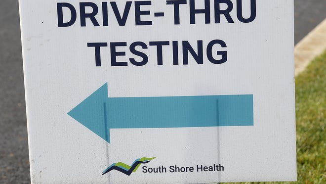 A COVID-19 testing sign is seen in this file photo at the South Shore Health drive through testing clinic on Longwater Drive, Norwell. Thursday July 30, 2020. Greg Derr/The Patriot Ledger