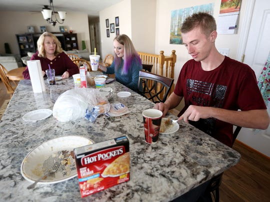Lisa, Haley and Brandon Vinson eat lunch at home in West Jordan on Thursday, Nov. 2, 2017. Brandon is in recovery from a heroin addiction.
