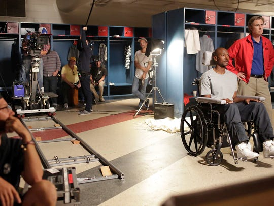 Movie crews work to film a locker room scene at Mississippi Veterans Memorial Stadium on Thursday. The movie is based on the story of, Chucky Mullins, a defensive back for Ole Miss who suffered an ultimately fatal injury 27 years ago.