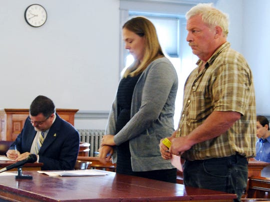Mark Johnson, right, stands next to public defender