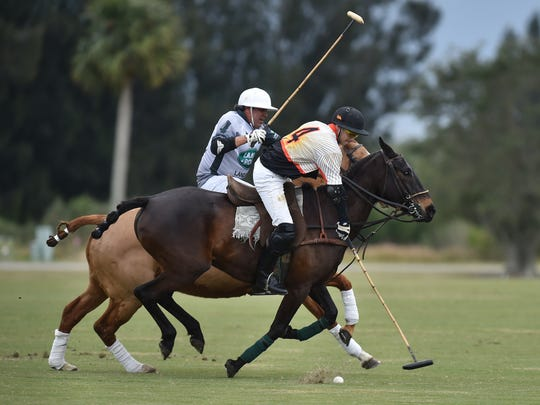 Jonny Lavine, of the University of Miami (front), tries to redirect the polo ball from Cuko Escapite, of Jaguar Land Rover of the Treasure Coast, during the second chukker of a Red Robin Tournament at the Vero Beach Polo grounds on Sunday, Jan. 7, 2018, just south of Point West in Vero Beach. The opening match of the Polo season for Vero Beach Polo Club included the University of Miami, BG Vero Beach Polo, and Jaguar Land Rover, with each team playing two chukkers against each other during the six chukker tournament. To see more photos, go to TCPalm.com. CQ: Johnny Lavihe, Cuko Escapite