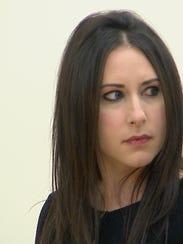 Kelly Gribeluk listens as Susan Bernstein gives a victim's