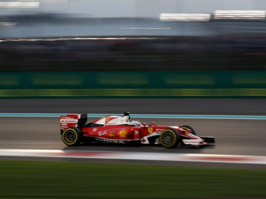 Ferrari driver Sebastian Vettel of Germany steers his car during the Emirates Formula One Grand Prix at the Yas Marina racetrack in Abu Dhabi, United Arab Emirates, Sunday, Nov. 27, 2016. (AP Photo/Hassan Ammar)