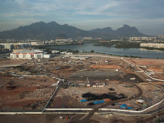 FILE - This May 13, 2014 file photo shows an aerial view, shot through an airplane window, of Olympic Park under construction in Rio de Janeiro, Brazil. Rio Olympic organizers, criticized over delays with the games barely two years away, announced through a statement on Wednesday, May 14, 2014 that several of the permanent venues are ready. (AP Photo/Felipe Dana, File)