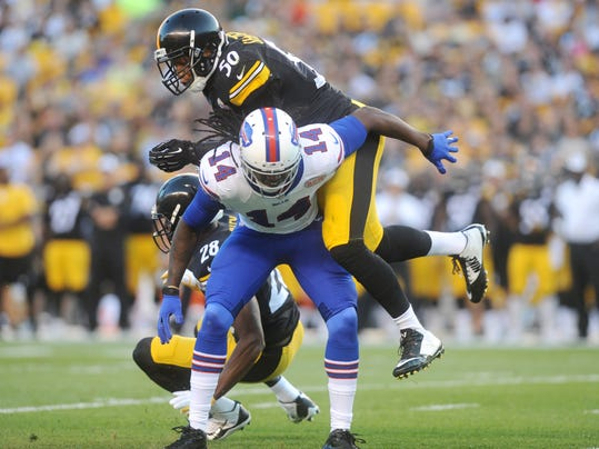 Pittsburgh Steelers outside linebacker Ryan Shazier (50) hits Buffalo Bills wide receiver Sammy Watkins (14) in the first quarter of an NFL football preseason game on Saturday, Aug. 16, 2014, in Pittsburgh. (AP Photo/Vincent Pugliese)