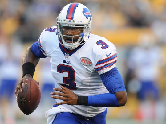 Buffalo Bills quarterback EJ Manuel (3) runs with the ball in the first quarter of an NFL football preseason game against the Pittsburgh Steelers on Saturday, Aug. 16, 2014, in Pittsburgh. (AP Photo/Don Wright)