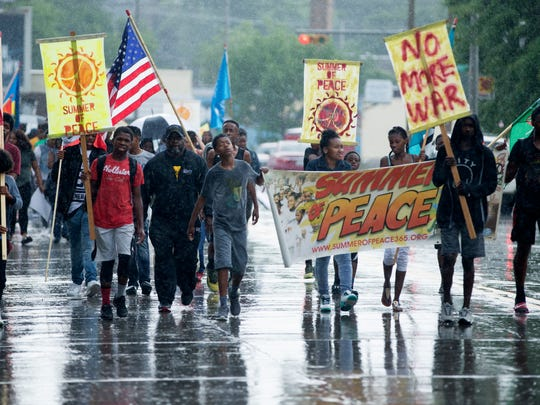 Supporters march up Martin Luther King Drive during