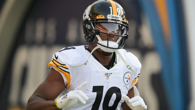 FILE - In this Sunday, Oct. 13, 2019, file photo, Pittsburgh Steelers wide receiver JuJu Smith-Schuster enters the stadium before an NFL football game against the Los Angeles Chargers, in Carson, Calif. Three years ago, the Steelers wide receiver was the youngest player in the league. Now he's the most experienced wide receiver in the locker room and finds himself facing an uncertain future entering the final year of his contract.