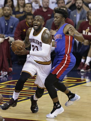 Rookie Stanley Johnson, right, plays tough defense on Cavs' LeBron James during Game 2 on Wednesday.
