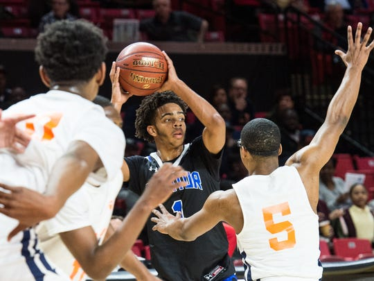 Decatur's Kevon Voyles (1) looks for pass during a game against Baltimore Polytechnic at the Xfinity Center College Park on Thursday, March 8, 2018.