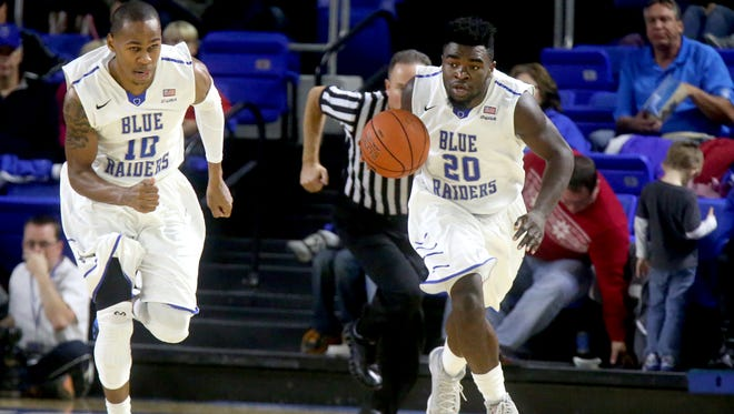 MTSU's Giddy Potts (20) takes the ball down the court behind teammate Jaqawan Raymond (10) during the game against Belmont. The Blue Raiders take on Georgia State on Tuesday.