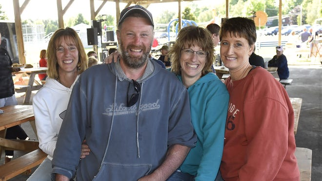 Pete Peot of Sevastopol poses with his sisters, from left, Carol Linskens of Luxemburg, Patty Reske of Germantown and Barb Loomis of De Pere during a community benefit for Peot on Sept. 16, 2017, at Sevastopol Town Park. The sisters nearly lost their little brother in a farm accident when his arms  were trapped in a hay baler in June.