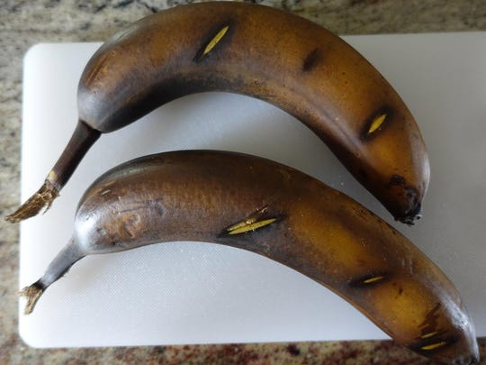 To get your not-quite-ripe bananas ready for banana bread, pop them into a 300-degree oven for 15 to 30 minutes until the skins are black. Scoring the bananas will help keep them from oozing too much.