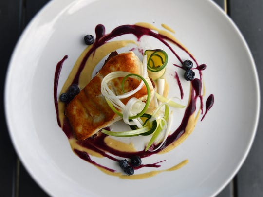 Seared halibut, squash potato gratin, summer squash and blueberry agrodolce from Ferndale's Local Kitchen and Bar.