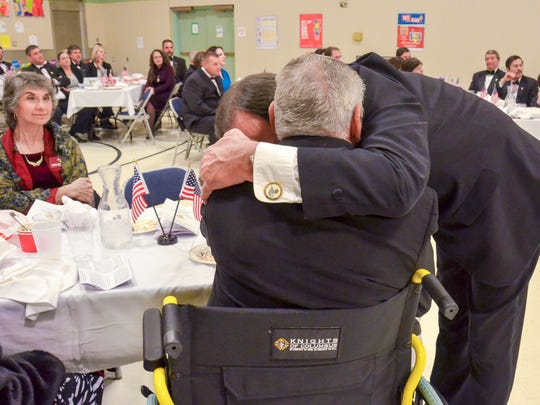 The Knights of Columbus present a wheelchair to Veteran Charles Dover.