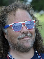 Arnold Gurule of Midway shows his patriotic pride at the Red, White & Blue Festival at ASUMH on Saturday.