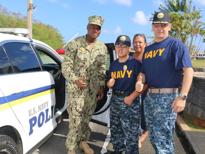 Robert Blas, center, was enlisted into the U.S. Navy