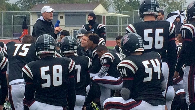 Elmira head coach Jimmy McCauley talks to his team after Saturday's 59-6 victory over Syracuse Nottingham.