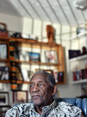 Charles Evers sits at his WMPR Radio station in Jackson, where his office is a virtual museum of his life and the civil rights movement.