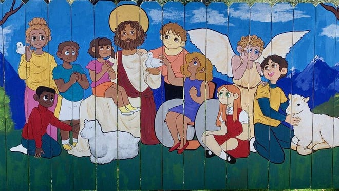 Dreyfoos School of the Arts visual arts student Priska Lambert painted a mural depicting Jesus surrounded by children on a playground fence at St. Patrick Catholic Church in Palm Beach Gardens.