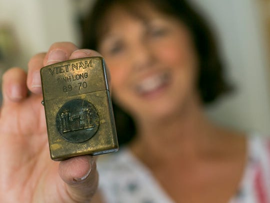 Linda Gayles holds a Zippo lighter on May 15, 2018, in Scottsdale. She had picked it up from a museum gift shop in Ho Chi Minh City, Vietnam.