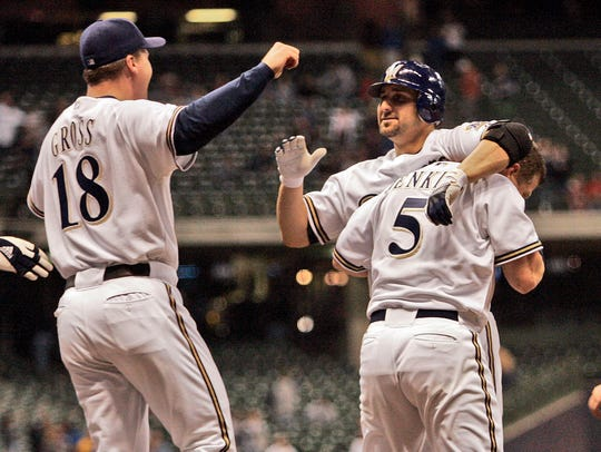Milwaukee Brewers' Tony Graffanino gets a bear hug