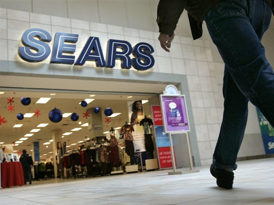 A shopper heads into the Sears department store at
