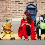 Oliver Mackenzie, 2, Jessica Mackenzie and Delainie Mackenzie wait for the PumpkinFest parade. Carlisle celebrated the arrival of fall and Halloween with the Carlisle Area Chamber of Commerce PumpkinFest on Oct. 24.
