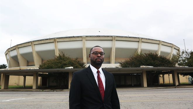 Memphis Housing and Community Development Director Paul Young poses for a portrait in front of the Coliseum on Nov. 1. The city of Memphis will mothball the shuttered building as it launches a $160 million redevelopment of the old surrounding Fairgrounds