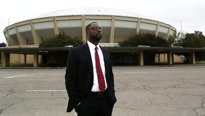 "November 1, 2017 - Memphis Housing and Community Development Director Paul Young poses for a portrait in front of the Coliseum on Wednesday. The city of Memphis will mothball the shuttered building as it launches a $160 million redevelopment of the old surrounding Fairgrounds, officials said Tuesday. Instead of rehabilitating the Coliseum, the city will spend roughly $40 million tying the redevelopment — whose theme is still competitive youth sports — into the Orange Mound community, said Young. That means improving access to the Fairgrounds from Orange Mound, the Beltline, Cooper-Young and the Greenline, and improving the historic Melrose High School. ""We want to have opportunities for those kids that aren't necessarily a part of some league or team to be able to come on the site and enjoy the benefits of it,"" he said."