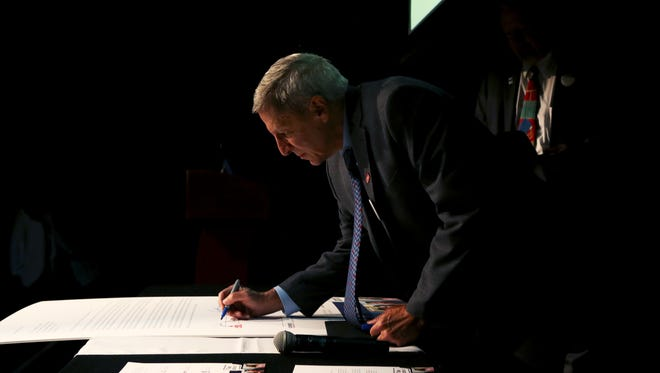 "November 15, 2017 - John Smarrelli, Jr., president of Christian Brothers University, signs a letter of support for the Dream Act with other university presidents to Senators Bob Corker, Lamar Alexander, and David Kustoff during ""The future of DACA, an analysis and panel discussion about the Dream Act"" at the Halloran Centre on Wednesday."