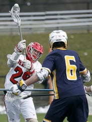Penfield's Dan Taddeo shoots against West Genesee in