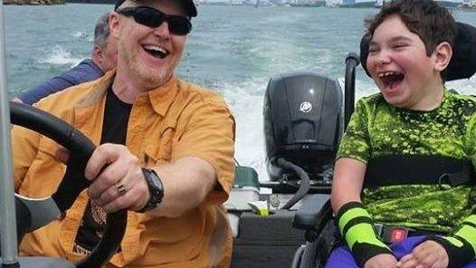 Bob Easterbrook, left, and Daniel Springer enjoy a fishing trip on the Detroit River. Daniel, 11, has cerebral palsy and loves traveling fast on the water.