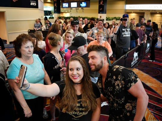 Chris Lane talks and takes photos with fans at the