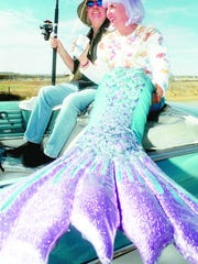 Rocker Graham Nash and his wife Susan, in a mermaid