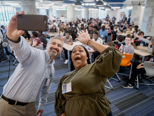 July 30, 2018  - Executive Director Chirs Terrill, left, and Principal Chandra Sledge-Mathias take a selfie with the student body during the first day of class at the new Crosstown High School. After three years in development in Crosstown Concourse the school, which focuses on connecting students to the real world through project-based learning, opened with its first class of 150 ninth grade students. The school plans to gradually increase enrollment to approximately 550 students.