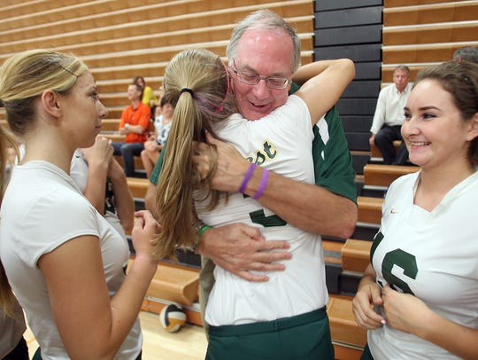 Ernie Found hugs West High volleyball player Mollie