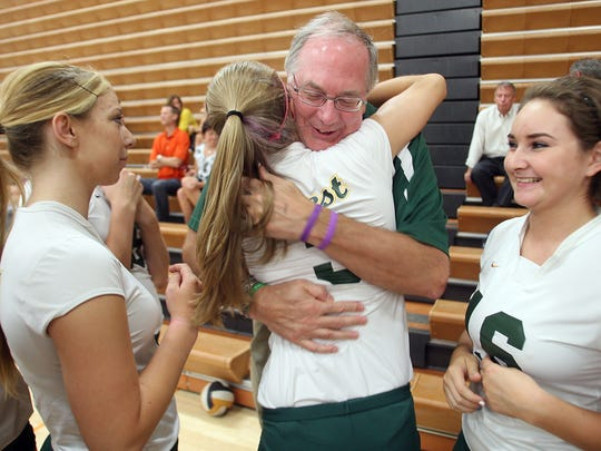 Ernie Found hugs West High volleyball player Mollie