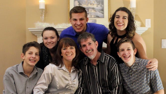 The Brown family, front from left: Josiah, Francie, Rob and Jacob; back row: Sarah, Justin and Jordan.